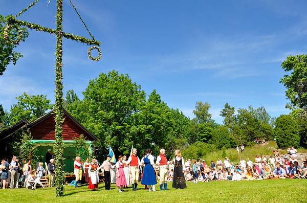 Folklore ensemble of Sweden in midsummer celebration.